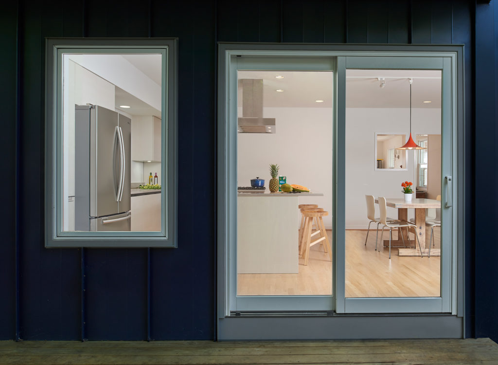 Natural light floods the remodeled kitchen from two oversized windows